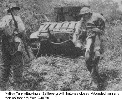 Matilda Tank attacking at Sattleberg with hatches closed. Wounded man and men on foot are from 2/48 Bn