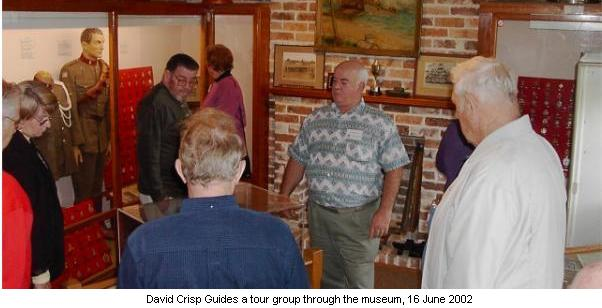 David Crisp Guides a tour group through the museum, 16 June 2002