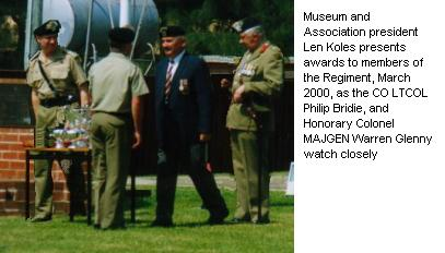Museum and Association president Len Koles presents awards to members of the Regiment