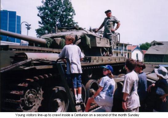 Young visitors line-up to crawl inside a Centurion on a second of the month Sunday