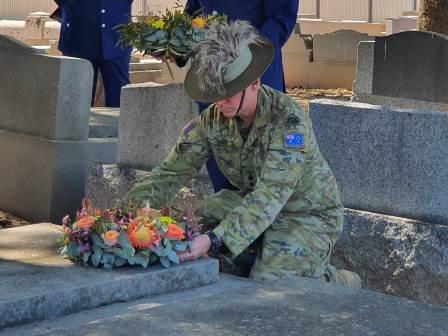Colonel White lays a Wreath
